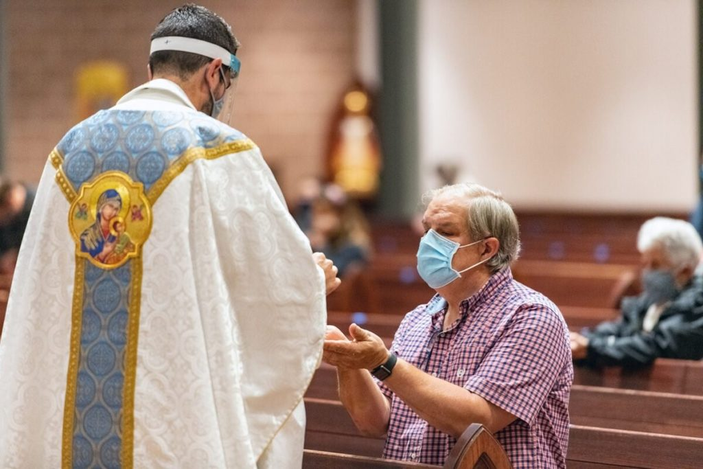 Mark Galli kneels during Mass at St. Michael Catholic Church on Sept. 8, 2020, in Wheaton, Illinois. RNS photo by Tom Killoran