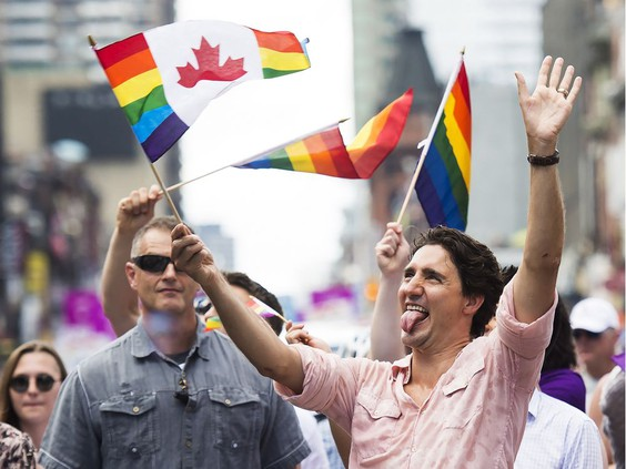 Prime Minister Justin Trudeau waves a flag as he takes part in the annual Pride Parade in Toronto on Sunday, July 3, 2016. PHOTO BY NATHAN DENETTE /THE CANADIAN PRESS
